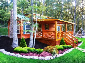 cabin with beautiful landscaping